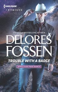 August 1_Trouble With A Badge_Delores Fossen